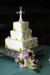 Wedding cake with flowers at a golf reception hall in The Woodlands Texas