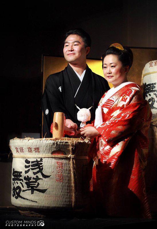 The traditional opening of the Sake during a wedding in Tokyo Japan