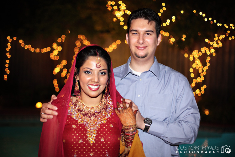 Husband and Wife smiling during the wedding reception in Dallas Texas