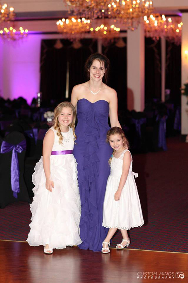 bridesmaid and flower girls posing at the Sterling Banquet Hall in Houston Texas