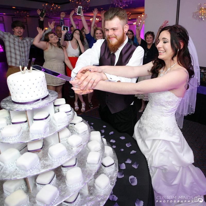 Bride and Groom cut the cake at the Sterling Banquet Hall in Houston Texas